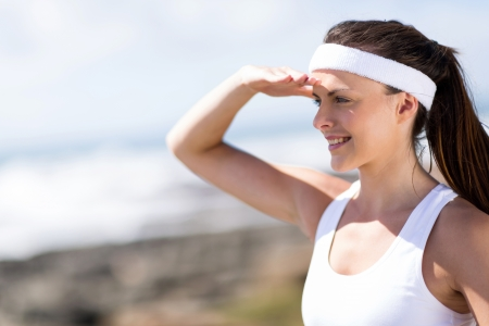 close up portrait of attractive fitness woman looking into distance photo