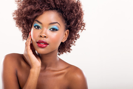 woman looking up: young afro american female model wearing colorful makeup