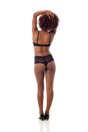 black lingerie: back view of sexy african american woman wearing black lingerie