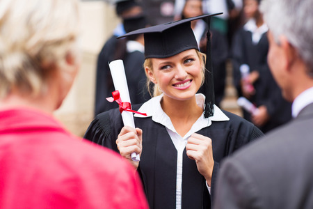 parents love: excited female college graduate looking at parents Stock Photo