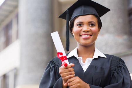 graduation gown: beautiful young afro american graduate holding diploma