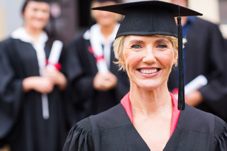 pretty middle aged university professor at students graduation ceremony Stock Photo