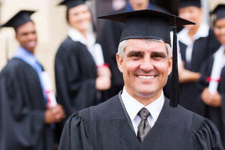 senior university professor in front of group of graduates photo