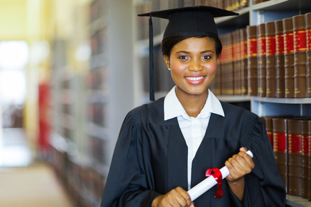 law library: pretty african university law school graduate on graduation day