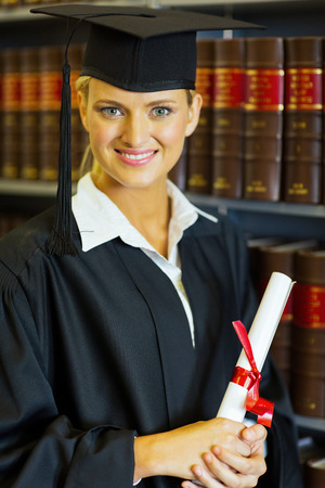 happy female law school graduate in university library photo