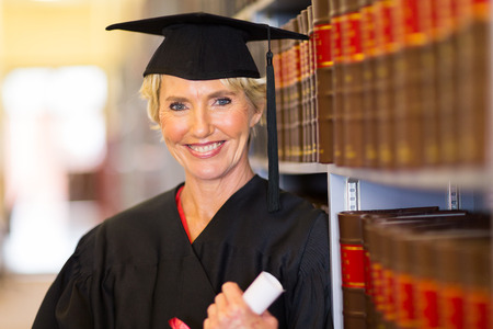 elegant middle aged female law school graduate in library photo