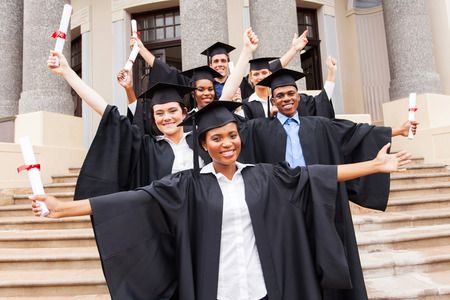 higher education: group of happy university students in front of university building