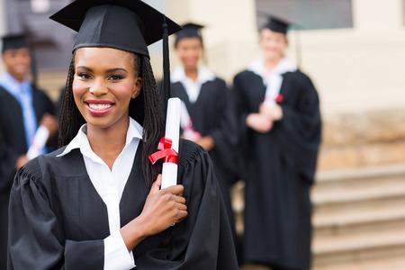 portrait of happy african female graduate at graduation photo