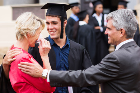 male parent: proud mother with tears of joy at her sons graduation