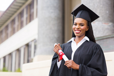 graduate students: beautiful african female student with graduation certificate Stock Photo