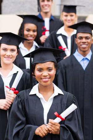 masters degree: group of college students in graduation gown Stock Photo