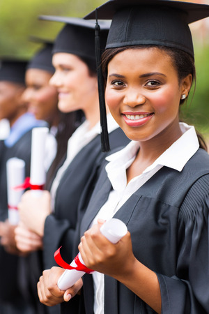 attractive african female graduate at graduation ceremony