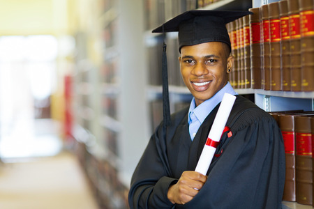 law school: happy african american law school graduate on graduation day Stock Photo