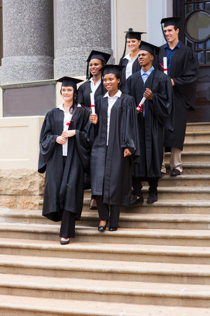 group of young graduates walking down the stairs after ceremony photo