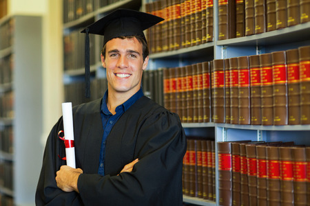 handsome university law school graduate in library photo