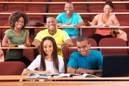 group of cheerful african college students in lecture room