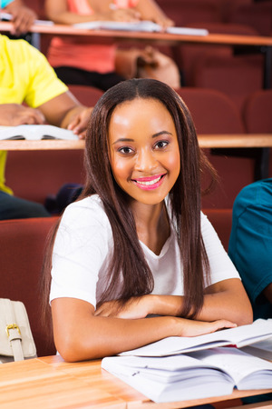 beautiful young african female student in class looking at the camera photo