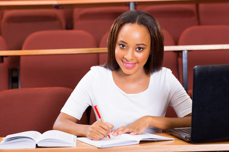 portrait of young female african college student studying in lecture hall photo