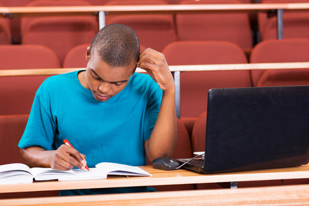 young african american college student studying in lecture hall photo