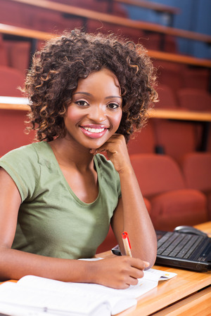 attractive female african american university student studying photo