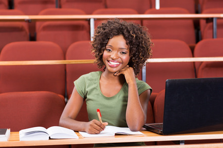 happy female afro american college student photo