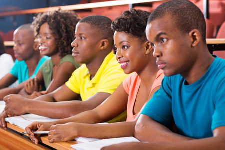 group of african american university students studying in lecture hall Stock Photo