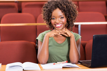 cheerful african college students in lecture hall photo