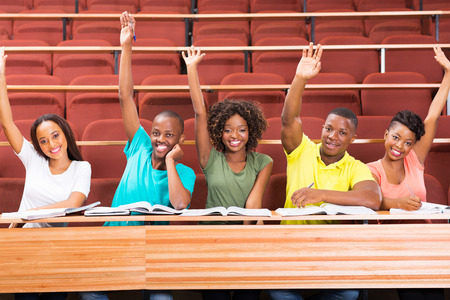 uni: group of african uni students arms up in classroom