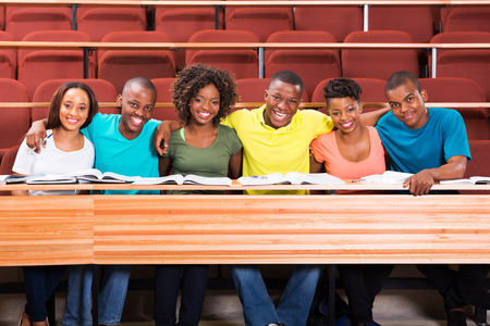 group of happy african college friends in lecture hall photo