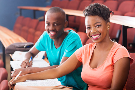 portrait of two african college students sitting in classroom photo