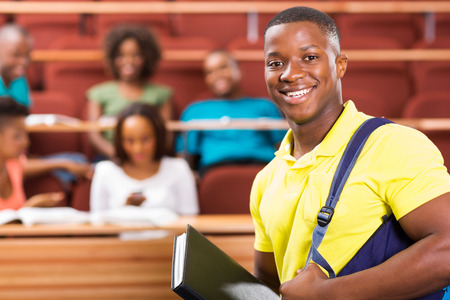 handsome african american college student in lecture hall photo