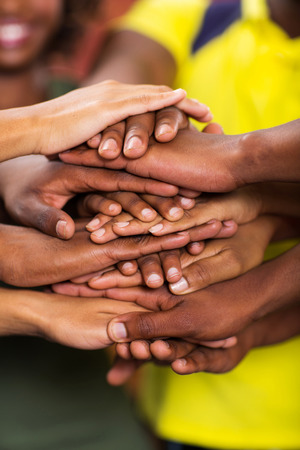 group of african students hands together closeup Reklamní fotografie