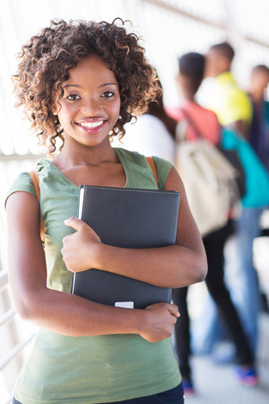 african student: beautiful female african college student on campus Stock Photo