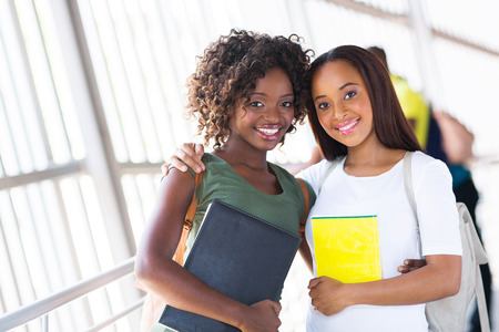 pretty african american college friends together on campus photo