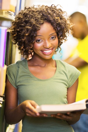 happy female african american college student in library photo