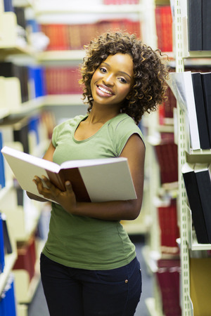 library student: beautiful afro american college student in library Stock Photo