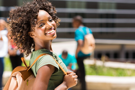 portrait of pretty young african american college girl on campus photo