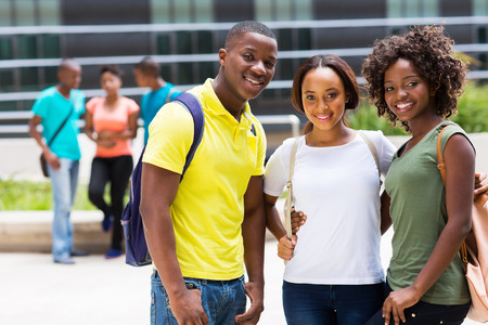 group of smiling african american college friends outdoors photo