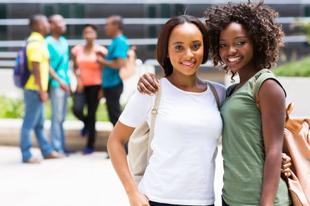 two beautiful african american college friends on campus