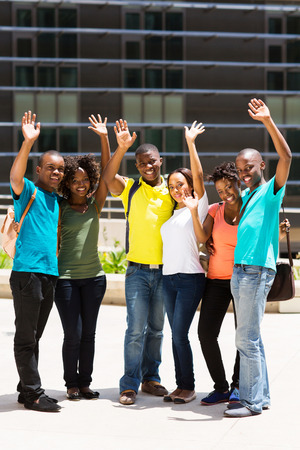 group of cheerful college students waving photo