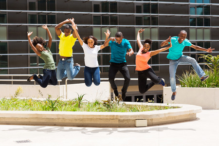 learners: group of happy african college students jumping high Stock Photo