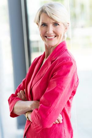 mature female: senior female corporate worker in office