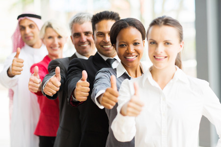 thumbsup: portrait of business team in a row giving thumbs up Stock Photo