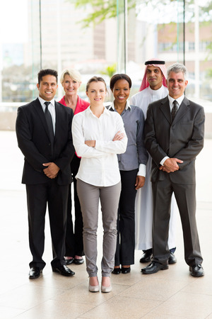 group of multiracial businesspeople standing together in office photo