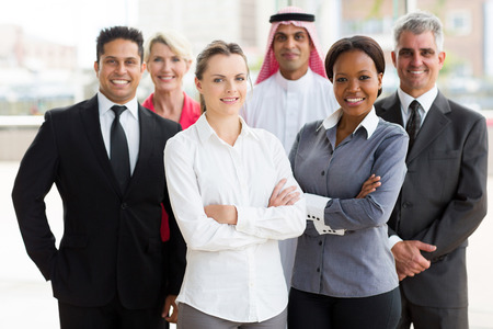 ethnic people: portrait of smiling multiracial business team in office
