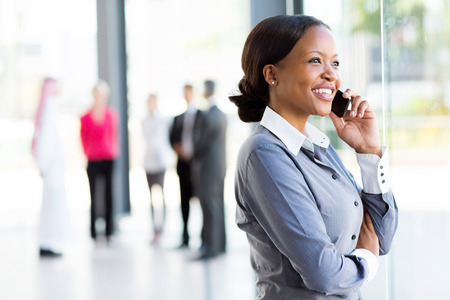 business woman phone: beautiful african corporate worker talking on mobile phone