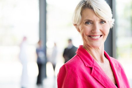 beautiful middle aged businesswoman in modern office Stock Photo