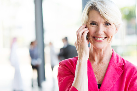portrait of senior businesswoman talking on cell phone  photo