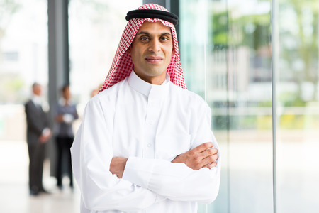 arab model: portrait of muslim businessman with arms crossed Stock Photo