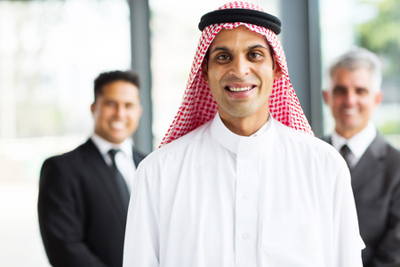 happy muslim businessman with team on background Stock Photo